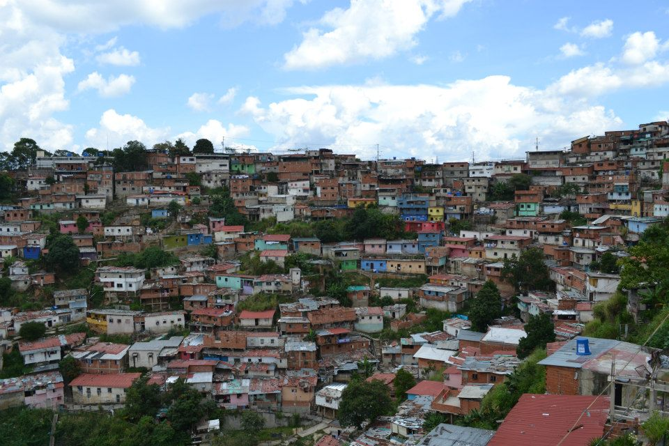 Venezuela's capital, Caracas, is ringed with barrios- shanty towns that sprung up in the last century as Dutch Disease strangled the agricultural sector. Venezuelans who moved from the countryside to the city often found nothing but these slums awaiting them. The world over, rural migrants are funnelled into our industrial cities looking for work. Instead, many end up as surplus labour, relegated to a periphery role in society. From Casablanca's muddy slums to the grimy rims of China's factory cities, this is a reality for millions of people worldwide. If the Chavez era achieved anything, it was including the people of the barrios into society. Venezuelans from poor areas like this make up the support base of Chavismo. People from places like this came down from the hillsides to demand Chavez's return when he was temporarily ousted from power by a US backed coup in 2002. Today, barrios across the country are being rehabilitated under Barrio Tricolor, a national project aimed at refurbishing the barrios; maintaining their cultural significance, but improving conditions and safety.