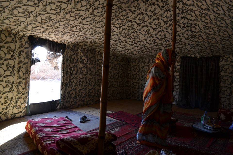 The inside of a jaima, the traditional Sahrawi tent. For centuries the people of Western Sahara have used tents like this while moving across the desert. By the 9th Century, the region may have been a notable trade route for caravans between Marrakesh and Tombouctou, making tents like the jaima a logical choice of shelter for people on the move. Sahrawi I met living under Moroccan occupation said that authorities have banned the erecting of jaima anywhere in the desert. In the Polisario camps, however, along with mudbrick huts these tents are the only shelter for many families.