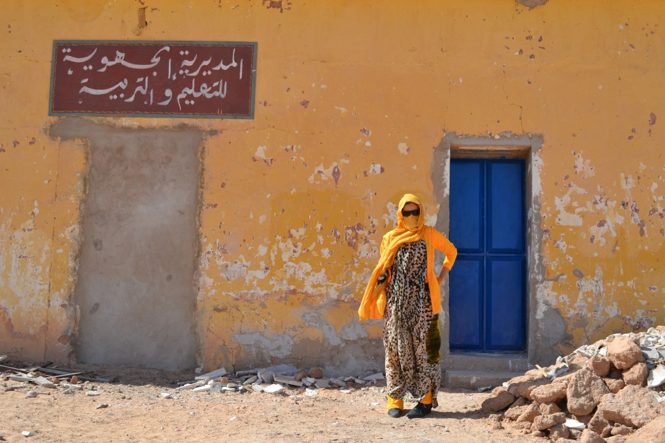 "A Sahrawi refugee outside a hospital in Western Sahara's ""February 27"" camp. Hospital staff told me that they rarely have enough medical supplies to satisfy demand; everything from painkillers to bandages are apparently in short supply. Summer is particularly bad; when temperatures soar beyond 50°C, the medical staff are all too often overwhelmed. However, the worst shortage is of doctors. Refugees are increasingly able to study in countries like Cuba, Venezuela, Algeria and Spain, but for now there simply aren't enough doctors to go around. February 27 is one of six of the Polisario's refugee camps on the Algerian border. Algerian authorities estimate there are around 165,000 refugees. This figure is supported by the Polisario movement, but disputed by Morocco. Most estimates of the population range between 100,000 to 150,000. Read more about Western Sahara here."