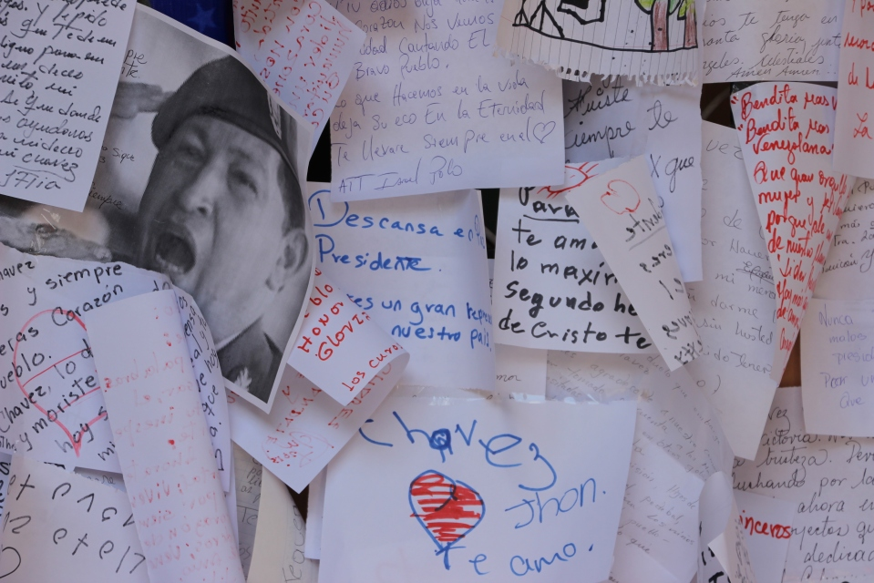 Messages to Chavez plastering the walls of council chambers in Merida, Venezuela. These letters were affixed to the walls by supporters in the days after his death. Many Chavistas continued to linger in the square in front of the chambers for hours after farewelling their former president.